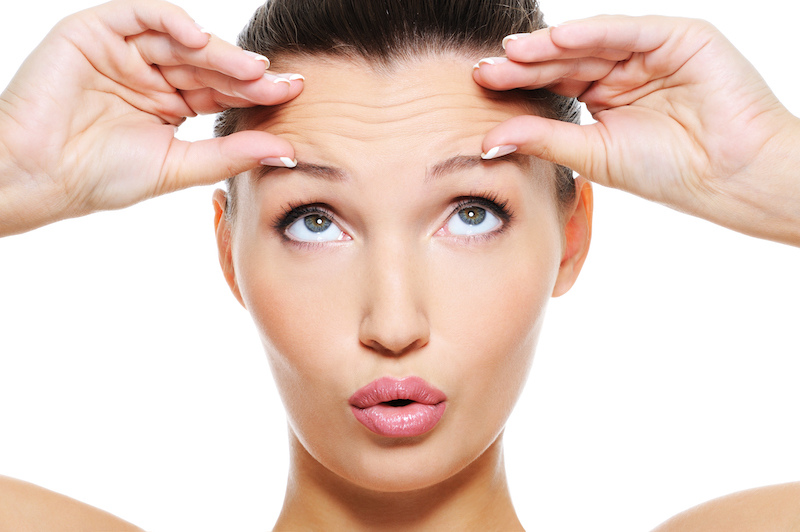 woman raising eyebrows